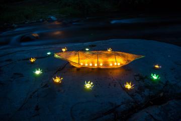 Canoe lighting the darkness